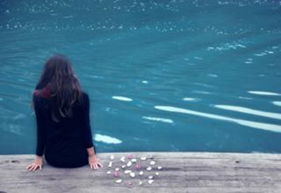 Lonely Sad Girl by Dock and Water